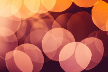 真正的橙色抽象散景灯